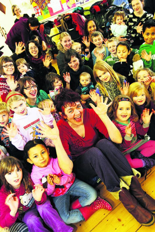 FEELING GROOVY: Su Frizzell, known as Groovy Su, leads the fun at a family event at the Ark T Centre