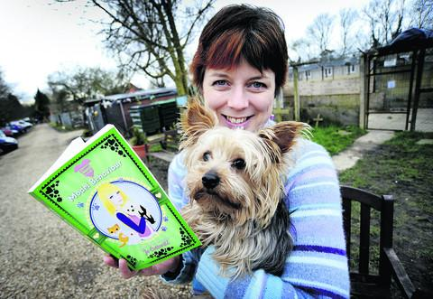 WINNING WORDS: Author Jo Cotterill pictured with her book Model Behaviour and the warden's dog Mickey at the Oxford Animal Sanctuary, Stadhampton, where the romantic novel is based