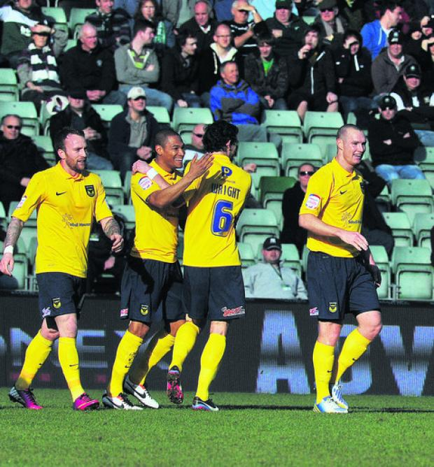 Oxford United celebrate after James Constable (right) puts the U's ahead at Plymouth