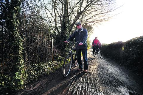 The Oxford Times: John Batey, pictured front on the track which runs from Croft Road recreation ground to Edgeway Road, Marston, is among cyclists campaigning about the condition of cycle routes in Oxford. Picture: OX57466 Richard Cave