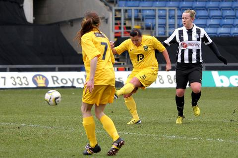 Natasha Caswell fires home United's second goal against Newcastle