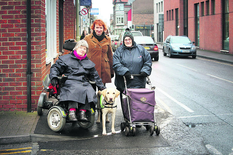 Cllr Lynda Atkins, centre, with Liz McIntyre and her dog Arnie, and Ivy Small at one of the new dropped kerbs installed in Wallingford town centre