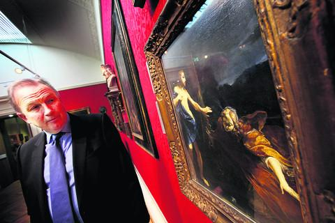 Ashmolean director Prof Christopher Brown with one of the paintings