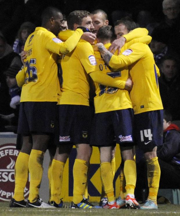 Oxford United have claimed their best recent results away from home, most notably at Gillingham on Tuesday night (left), to the delight of their travelling support (right)