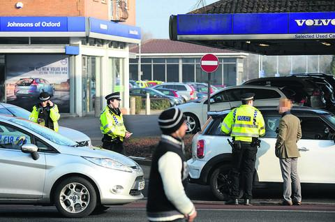 Trapped: Police apprehend motorists using park-and-ride lane