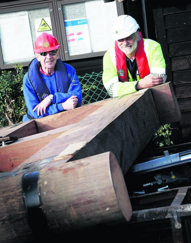Volunteer Mike Sinclair, left, with Iffley lock keeper Ian Westwood and one of its new gates