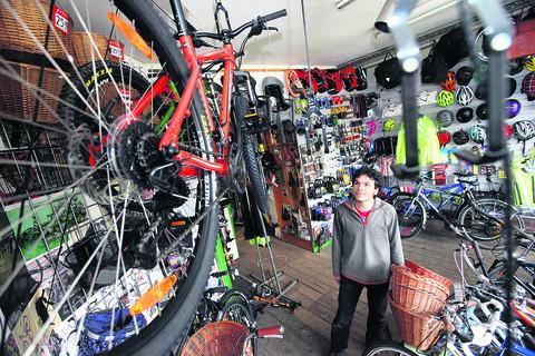 David Taylor, of Walton Street Cycles, looks at the rack were the bikes were hanging