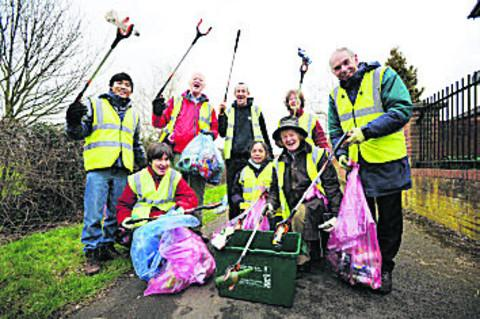 volunteers picking litter from hedge bordering Gillians Park, Blackbird Leys