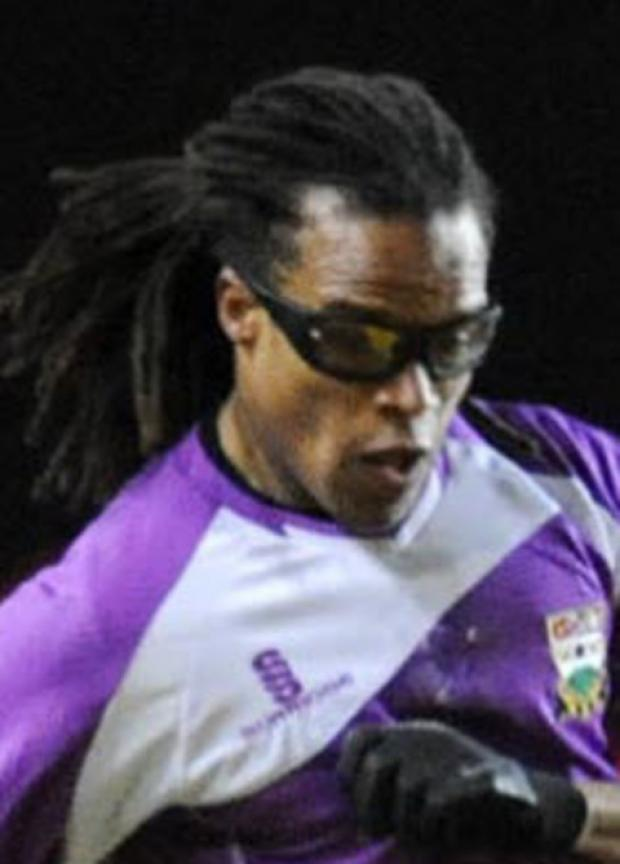 Edgar Davids in action for Barnet against United