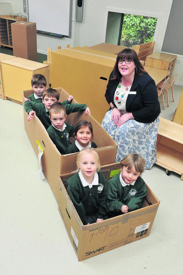 The Oxford Times: Head Sally Clarke with, from back, Oliver Townsend, Jules Hartless, Caspar Wright, Aleksandra Jankowska, Emily Young and Leonard Butterfield-Price having fun with the furniture boxes. Picture: OX57804 Denis Kennedy