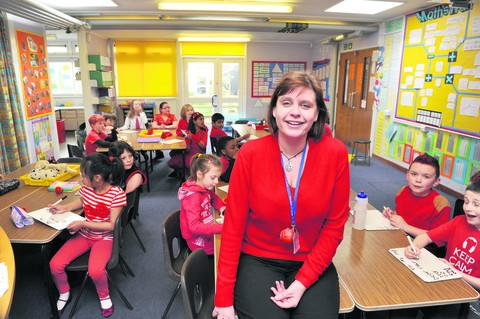 Deputy head of Berinsfield Primary School, Helen Smales, takes a classs of Year 4 children. Picture: OX58016 Denis Kennedy
