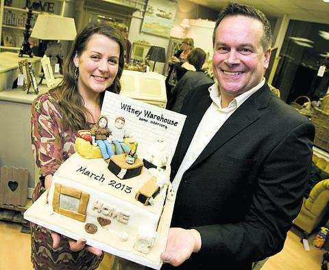 Witney Warehouse's Justine Davidson and Gary Soame celebrate reopening with a specially-made cake