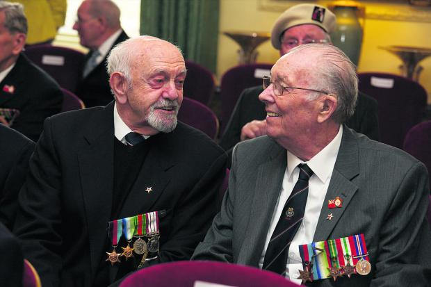 Edward Cordery, left, chats to another convoy veteran at Downing Street