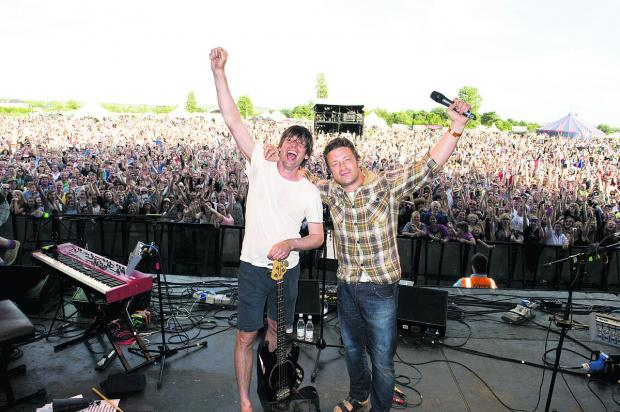 Alex James, left, and Jamie Oliver on stage at last year's Feastival