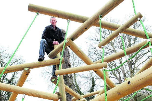 Director Colin Shone, pictured trying out the new climbing frame,
