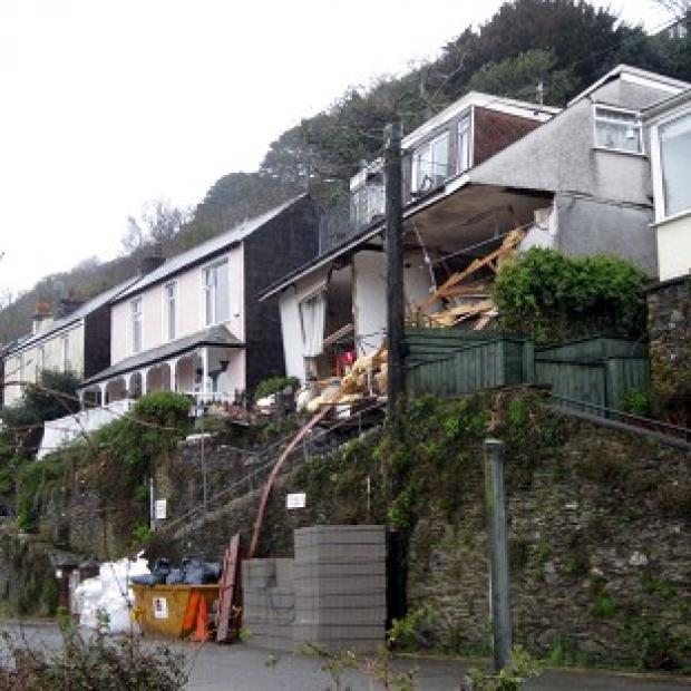 The collapsed flats on Sandplace Road, East Looe, Cornwall, where one of the occupants is unaccounted for