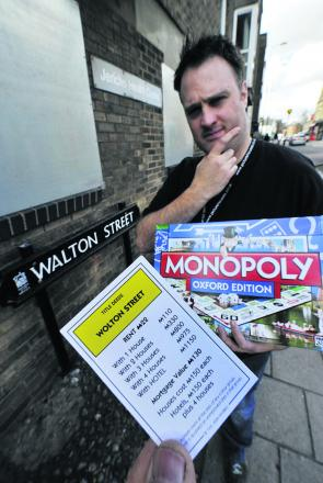 Phoenix Picturehouse assistant manager Matt Taylor with the rogue Monopoly card in the real Walton S