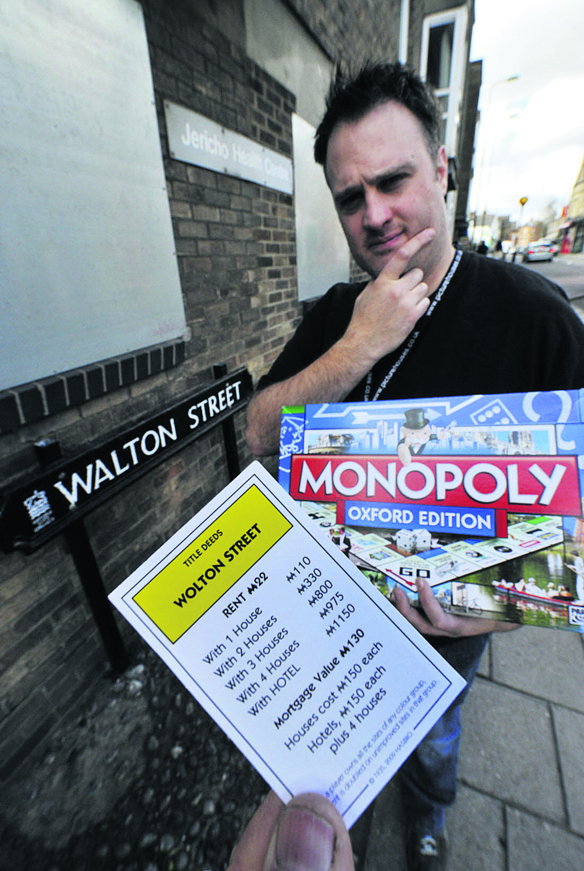 Phoenix Picturehouse assistant manager Matt Taylor with the rogue Monopoly card in the real Walton Street