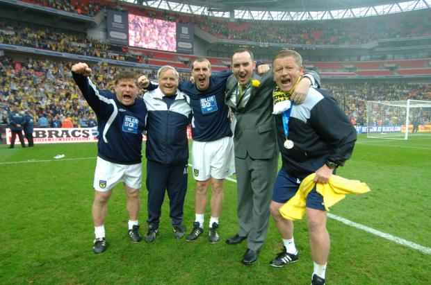 The Oxford Times: Chris Wilder celebrates winning promotion at Wembley with his backroom team and chairman Kelvin Thomas