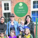 Outside Wolvercote Primary School, left to right, back: Payashi Garry holding Hannah Garry, Kerry Harries, Rosa Faulkner holding Otto Faulkner. Front: Joseph Garry, Isabelle Harries, Amaya Faulkner, Ixeya Faulkner and Alice Wilkinson. Picture: OX59199