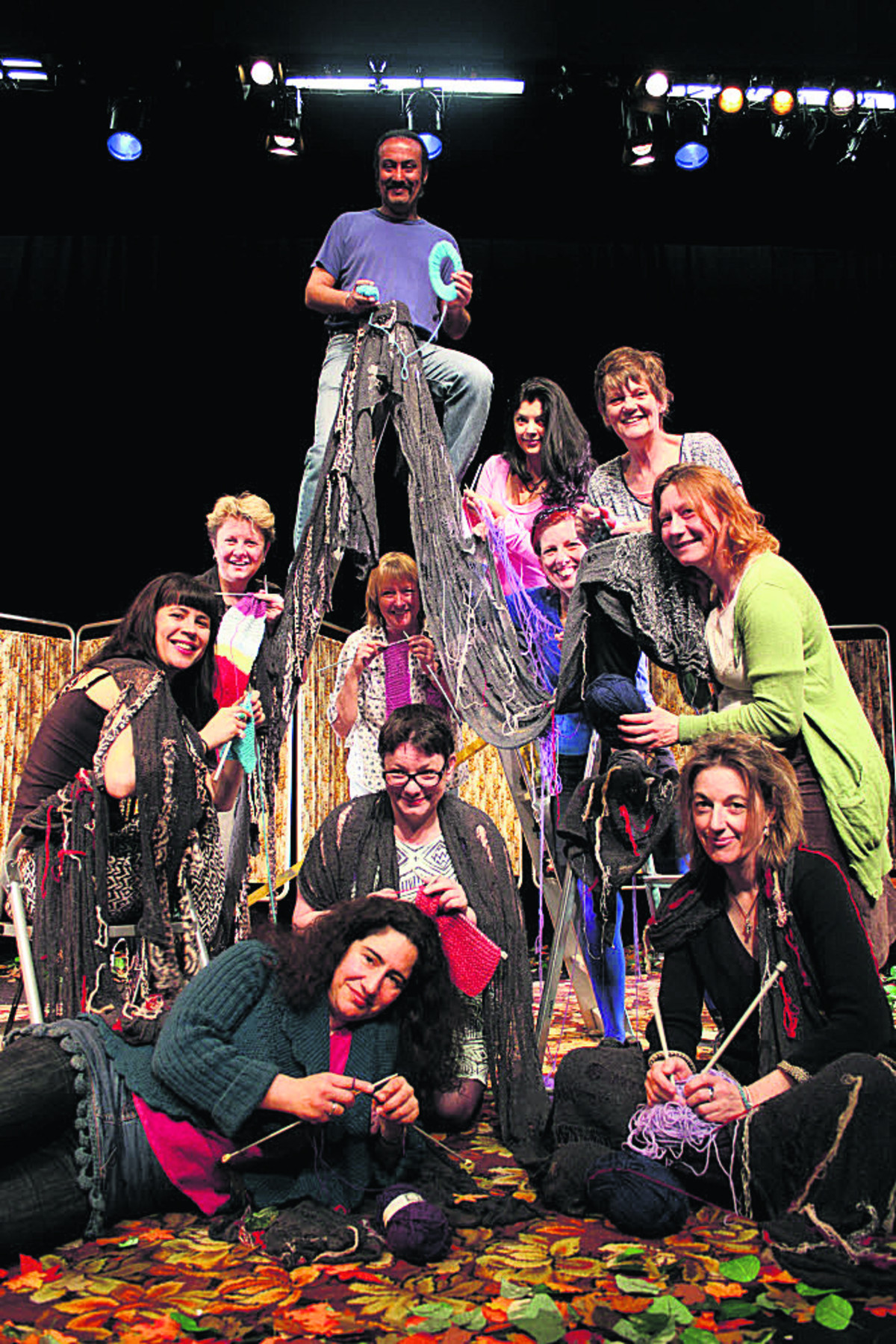 The Knitting Circle's Sanjiv Hayre is pictured on the ladder with fellow cast members, the writer, crew and volunteer knitters