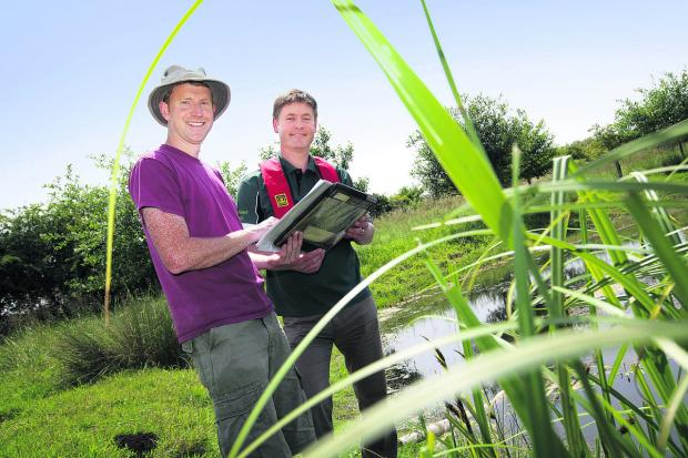Earth Trust estate manager Chris Parker, left, with Environment Agency biodiversity officer Jon Woodcock at a reed bed