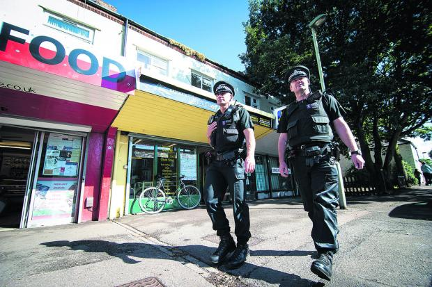 Acting Sgt Phil Gardiner and Sgt Alan Coffey on patrol yesterday near the Taste of Jamaica restaurant in Cowley Road where the incident happened