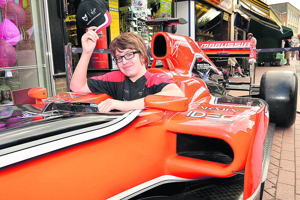 Sue Ryder charity shop volunteer Harvey Marshall, 15, in the Marussia F1 car