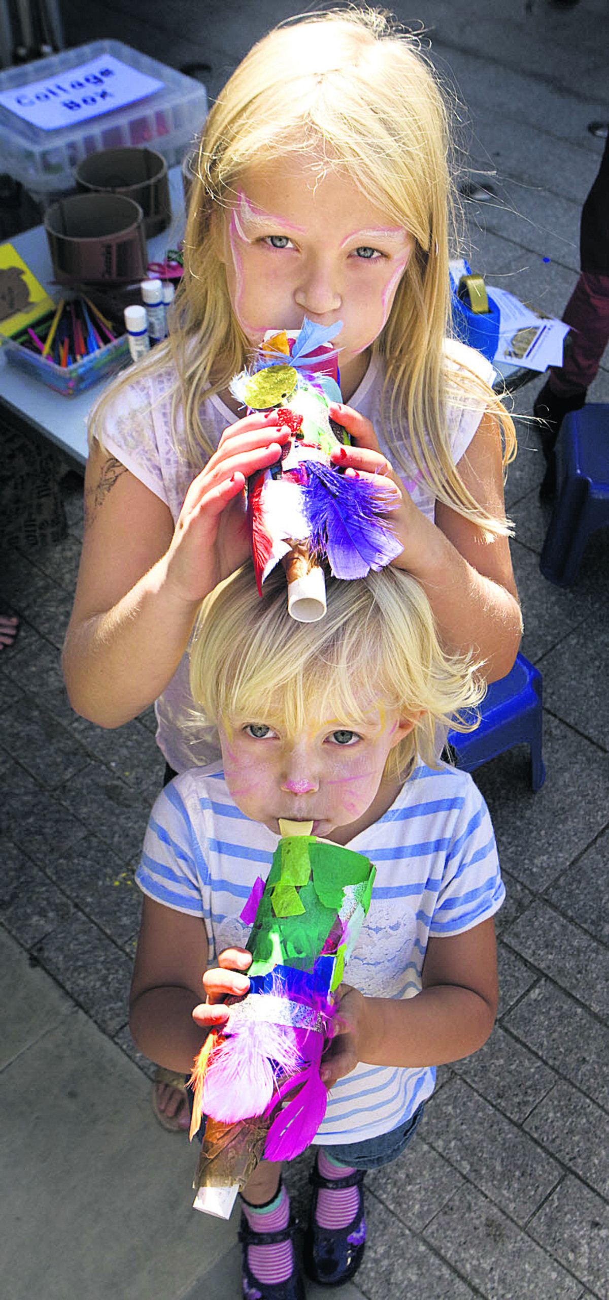 Evie Bath, eight, and Maisie Knight, four, with horns they made for the Junk Orchestra