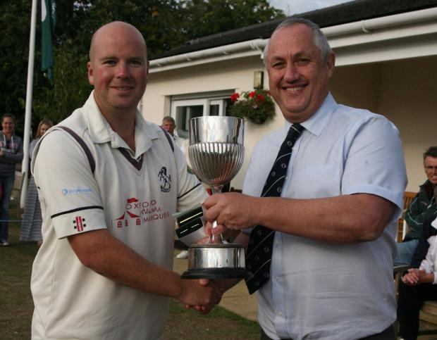 Horspath captain Will Eason receives the Oxfordshire Cup