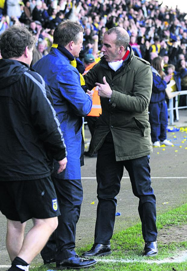 The Oxford Times: Paolo Di Canio has words with Oxford United boss Chris Wilder at the Kassam Stadium in March 2012 during his spell at Swindon