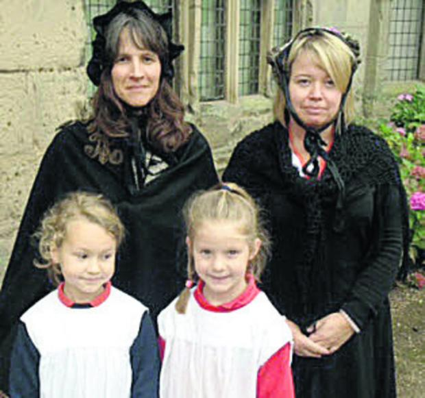 The Oxford Times: Issy Coventry, left, and Bethany Atherton with, back from left, Sally Gray and Rachel Blake during the Victorian day
