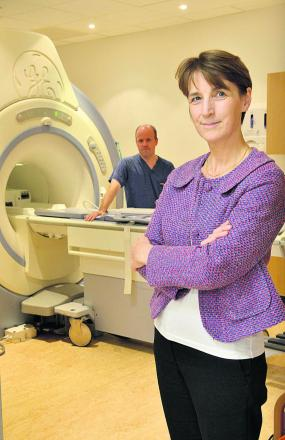 Prof Katherine Vallis and superintendent radiographer Anthony McIntyre with an MRI scanner