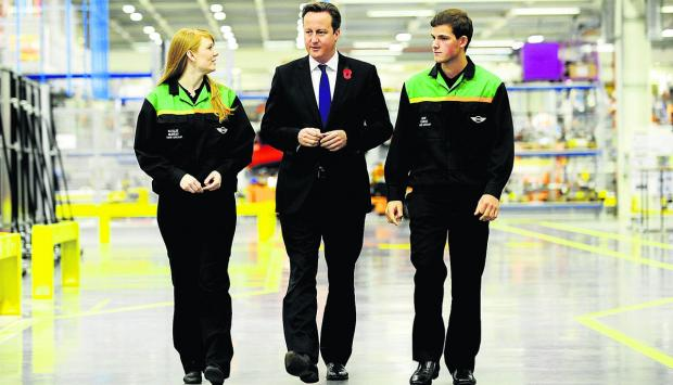 Prime Minister and Witney MP David Cameron unveiled his apprenticeships initiative at Mini Plant Oxford. Here he met and talked with apprentices Natalie Murray and Luke Pearce who backed his scheme