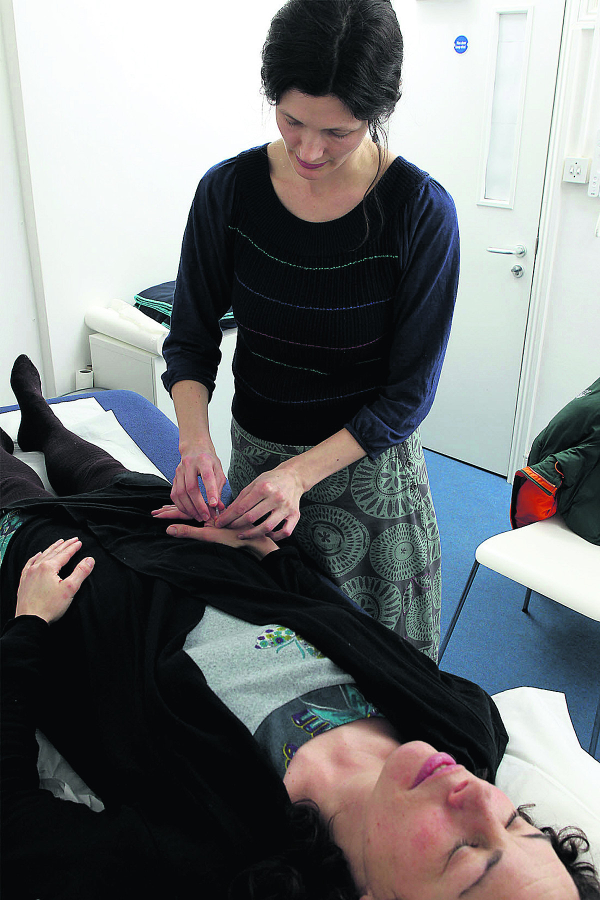 Acupuncturist Rebecca Minton at work in her treatment rooms