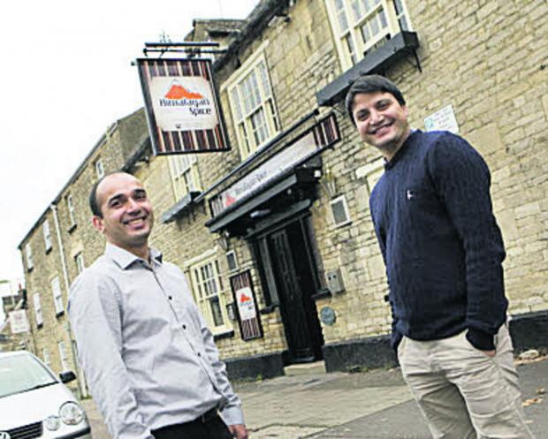 PEAK time: Joint managers Prakash Sharma, right, and Puru Sitaula outside their new restaraunt, Himalayan Spice, which used to be the Butchers Arms. Picture: OX63914 Antony Moore