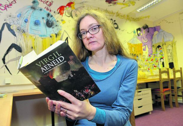 Dr Lorna Robinson with a copy of Virgil's Aeneid, which will feature in the Latin A-level