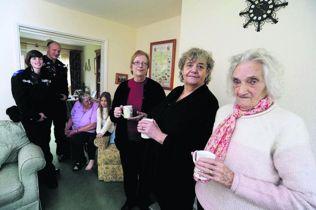The Oxford Times: From left, PCSO's Joanne Hopping and Miles Miller, next to, Jill Haynes, 74, with grandaughter, Freya Ashton, nine, Betty Welberry, 80, Shelia Boott, 64, and Doreen Sillman, 82. Picture: OX64380 David Fleming