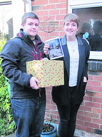 Students Gemma Pugh and Carl Bartlett, of Cooper School, deliver a hamper