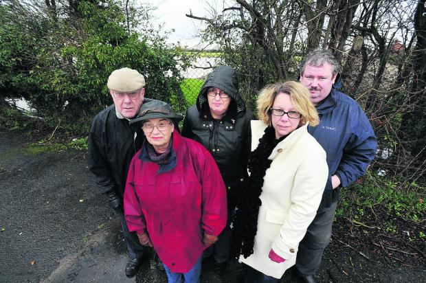 From left, Residents Eric and Betty Webb, Carole Denton, Vikki Hemming and Tim Taylor in front of the field where 31 homes are planned. Picture: OX64424 Jon