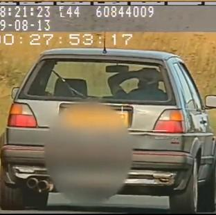 The Oxford Times: Video still issued by North Yorkshire Police showing Richard Newton, 36, driving at 60mph with no hands on the A171 near Scaling Dam reservoir in August of last year, as he has been banned from driving for 12 months at Scarborough Magistrates Court.
