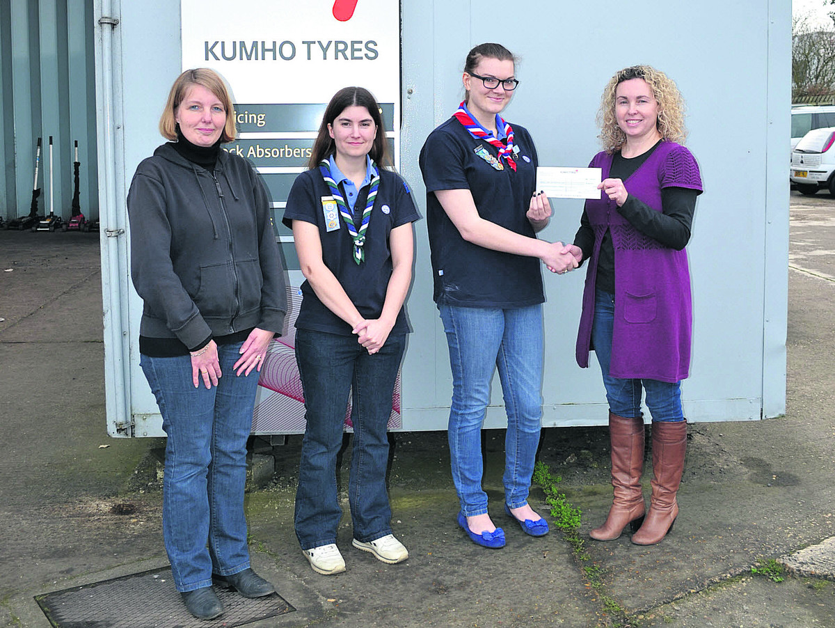 Lianne Hayday, right, of Kidlington Tyre & Exhaust Centre, presents the cheque to Kidlington Guides members, from left, Alison Aust, Becky Hinton and Nicola Fairgrieve