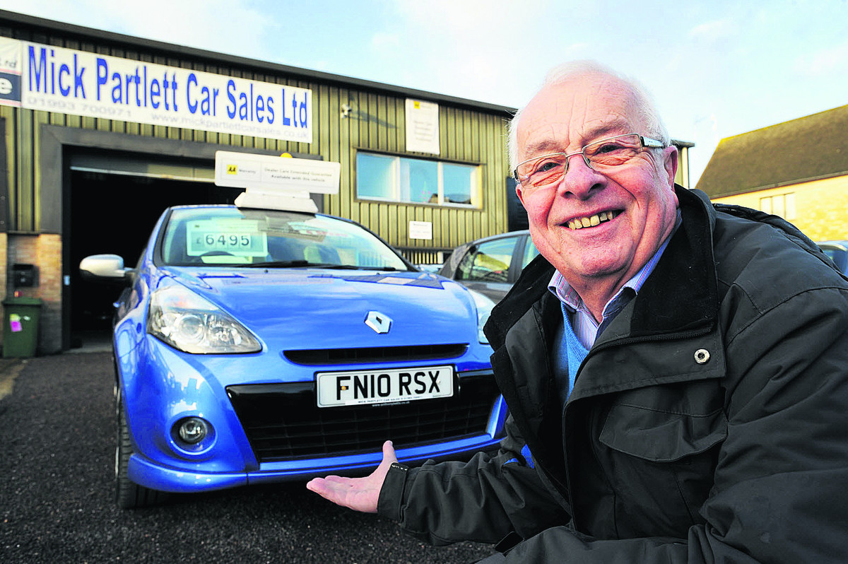 Mick Partlett with the Renault Clio which was stolen from his garage last November