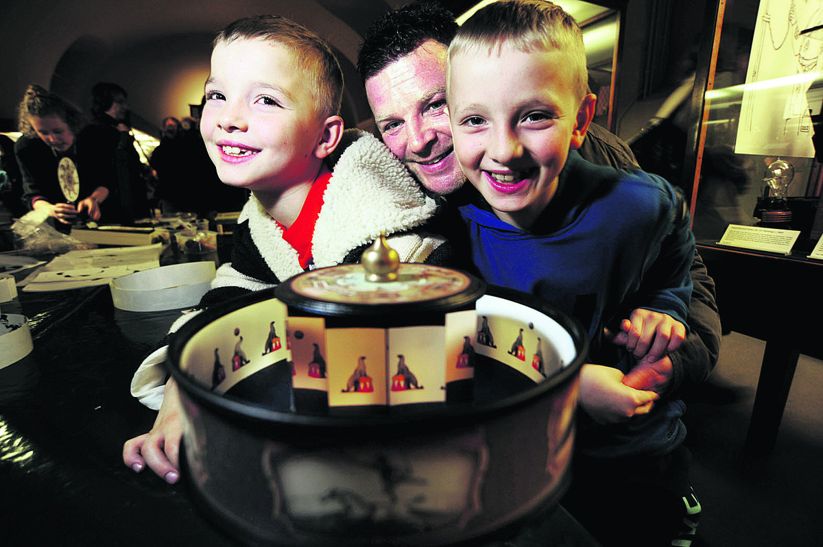 IMAGES: Connor, seven, and Kieran, 10, Cox, with dad Darren and a praxinoscope