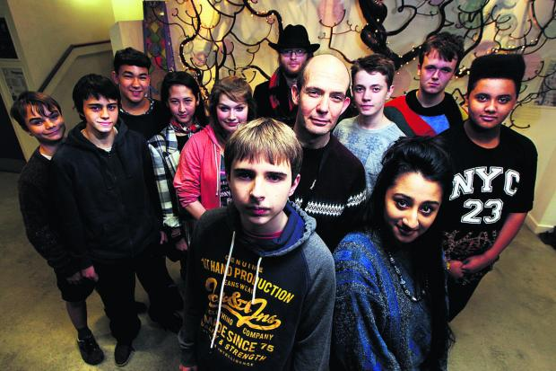 School friends Ryan Clune and Anusha Abbas have been campaigning against cuts set to be imposed on the Pegasus Theatre. Artistic director Jonathan Lloyd is pictured behind them.  Picture: OX64490 Ed Nix