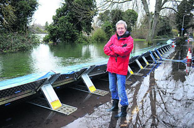 Bob Price at the flood defences.  Picture: OX64523 Marc West