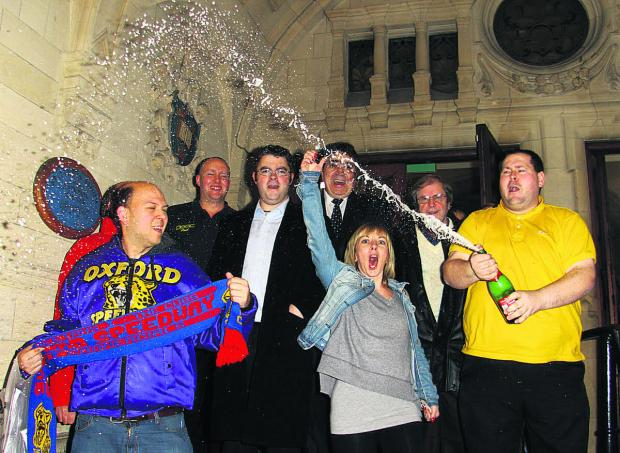 Campaigners celebrate the decision at the Town Hall