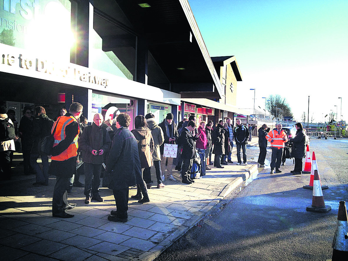 Queues of rail passengers outside Didcot Railway Station waiting for the replacment bus service after the suspension of the trains between Oxford and Didcot. Picture: Neil Braggins
