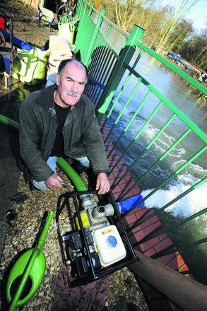 John Mastroddi, 64, helped his fellow residents in Kennington by installing water pumps at the end of his garden to pump water away from the hous