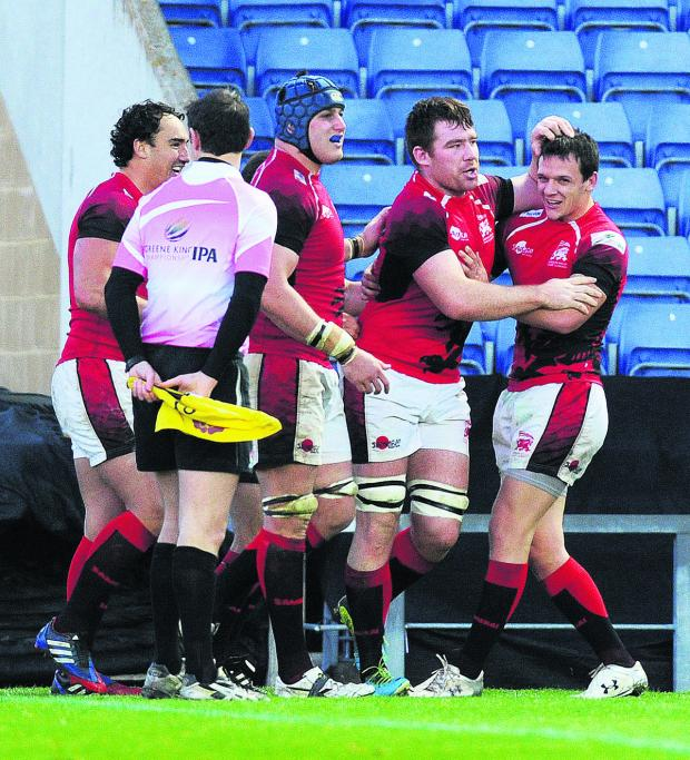 The Oxford Times: Ollie Stedman (second right), pictured celebrating his try against Bristol at the Kassam Stadium in November, retains his place to face Pontypridd, which Rob Lewis (right) will captain